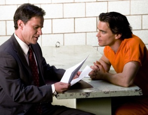 Tim De Kay as Peter Stokes and Matthew Bomer as Neal Caffrey in White Collar