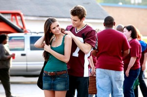 Nina Dobrev as Elena Gilbert and Paul Wesley as Stefan in The Vampire Diaries